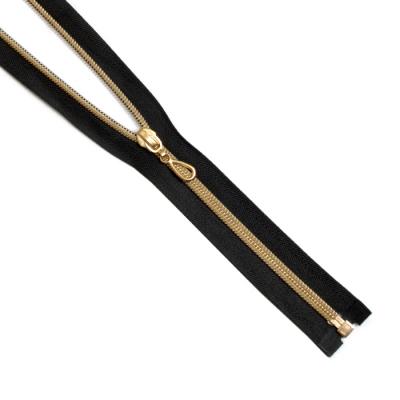 Молния Т7 декор. спираль 1-бег. 80 см золото/черн. «капля» в интернет-магазине Швейпрофи.рф