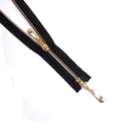 Молния Т7 декор. спираль 2-бег. 70 см  золото/черн. в интернет-магазине Швейпрофи.рф